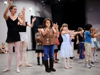 Ballet dancer leading class at Ballet Austin family dance workshop