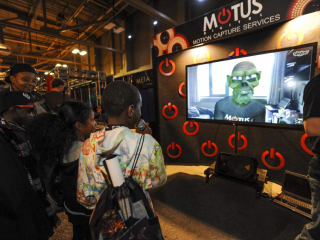 kids playing at the SXSW Gaming Expo 2013