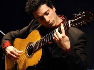 "classical guitarist Grigory ""Grisha"" Goryachev playing guitar"
