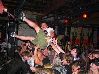 Fan crowd surfs at a Chaos in Tejas show in 2009