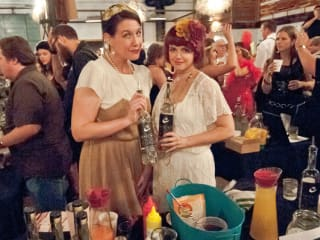 guests in period twenties costume at Edible Austin Sipping Social