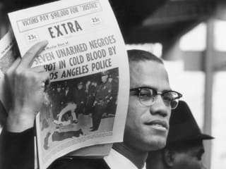 Gordon Parks Malcolm X Holding up Black Muslim Newspaper