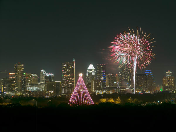 Trail of Lights tree Austin skyline