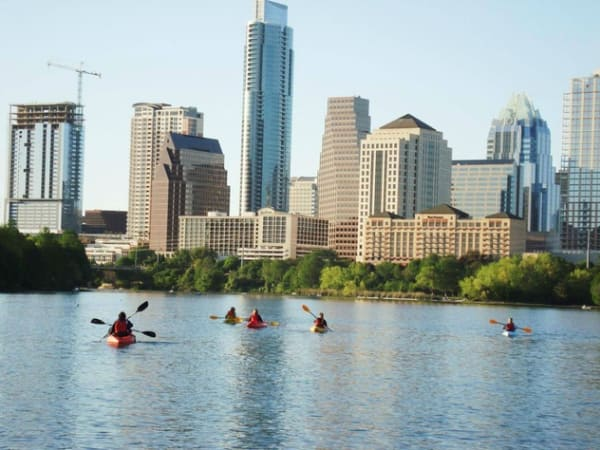 Austin skyline downtown Lady Bird Lake Town Colorado River kayaking