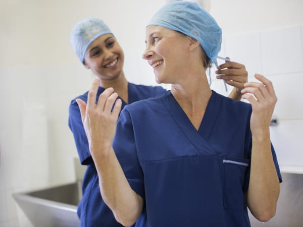 Two doctors preparing for surgery