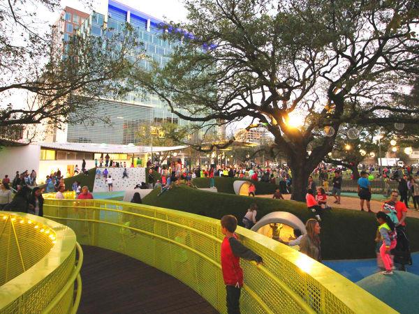Levy Park Houston oak tree park child