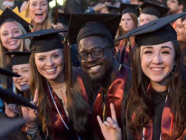UT Austin university of texas commencement students hook em horns