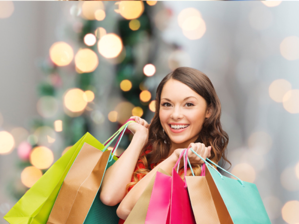Woman holding bags, Christmas shopping