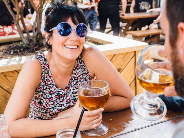 Rustic San Antonio happy hour woman beer patio couple