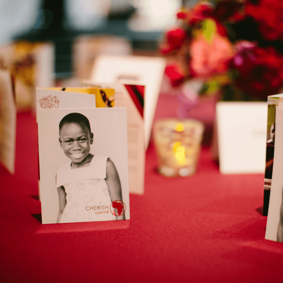 Cherish cards featuring children in Uganda add a personal touch to the table decor