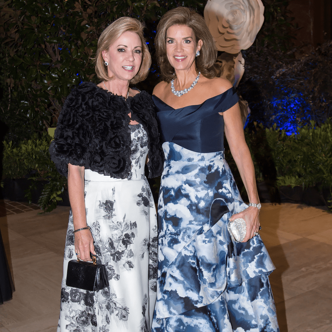 Vicki Chapman in Oscar de la Renta, Lisa Troutt in Carolina Herrera