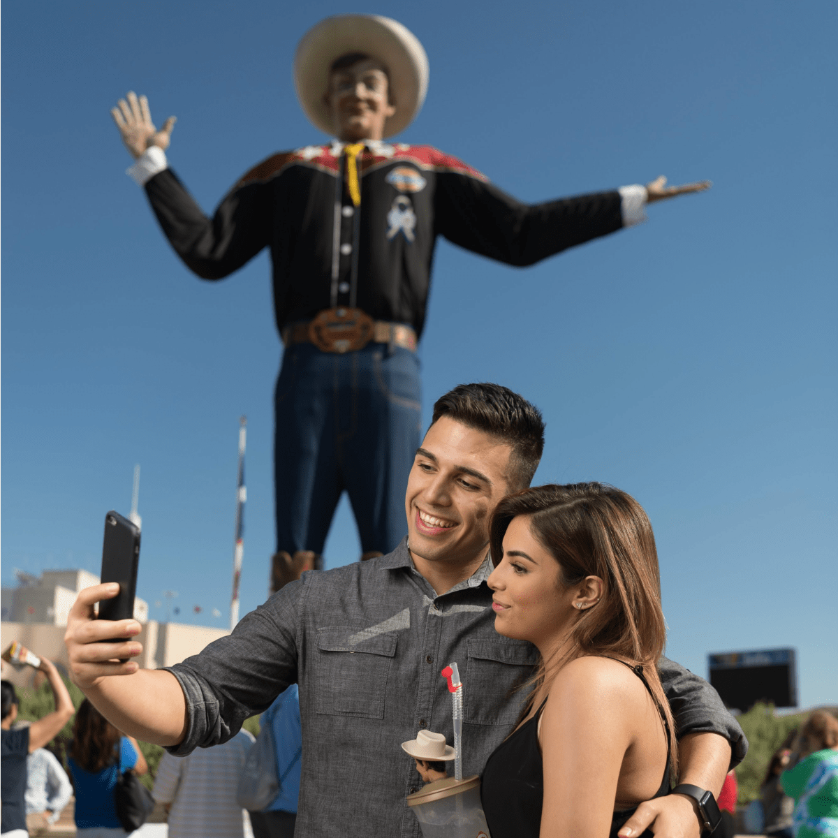 Couple taking a selfie with Big Tex