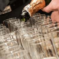 pouring champagne wine into glasses