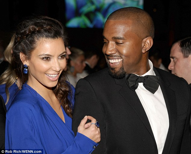Expecting: Kim Kardashian and Kanye West, pictured in October, have confirmed they are having a baby