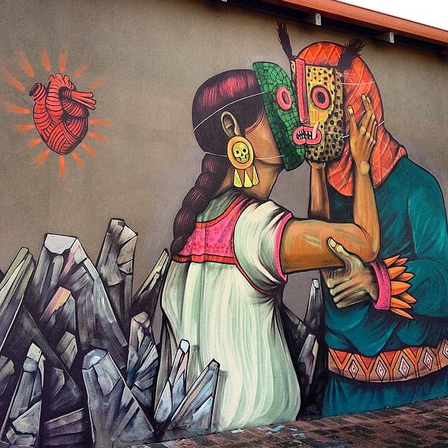 Edgar Flores Saner - Mural de una mujer indígena con una máscara que besa a un hombre indigena enmascarado