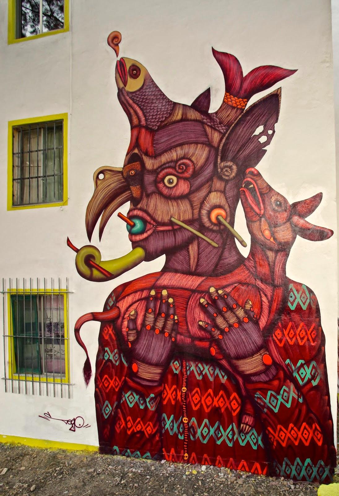Sego Ovbal - Proteo el protector - Mural con elretrato de la deidad en tonos rojos