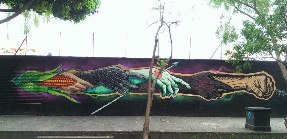 Dante Aguilera - mural de diferentes manos sonsteniéndose por los antebrazos