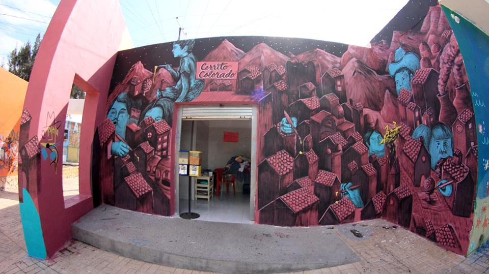Ezequiel Frías Cheke - Mural de pequeñas casas en un cerro con tonalidades rosa