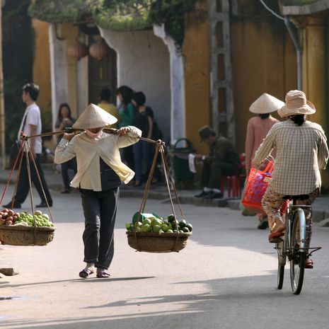 Vietnamese vendor in Hoi An, Vietnam