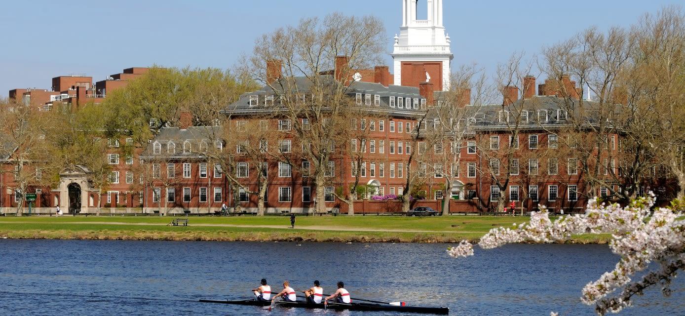 People rowing, running and walking around Harvard University, Boston
