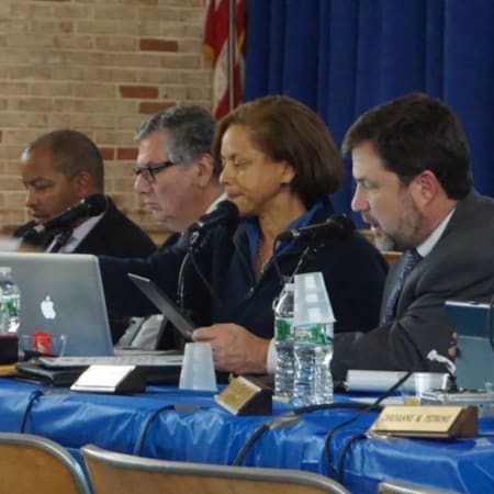 New Rochelle school officials - here at a previous Board of Education meeting - discussing the capital bonds project, which was approved on Tuesday.