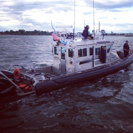 A crew from the Fairfield Police's Marine Unit rescued a man from neck-deep water near Penfield Reef.