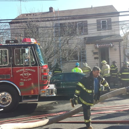 Port Chester firefighters battling a fire in the village in March. On Monday night, a 5-1 village board voted to eliminate the paid department, cutting eight career firefighter jobs.