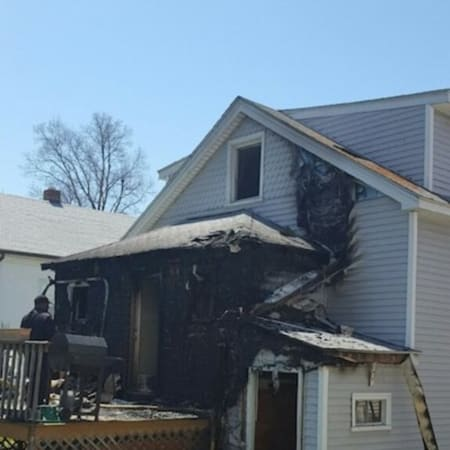 Fire damage was contained to the rear of a house on Webb Avenue in Stamford on Sunday.