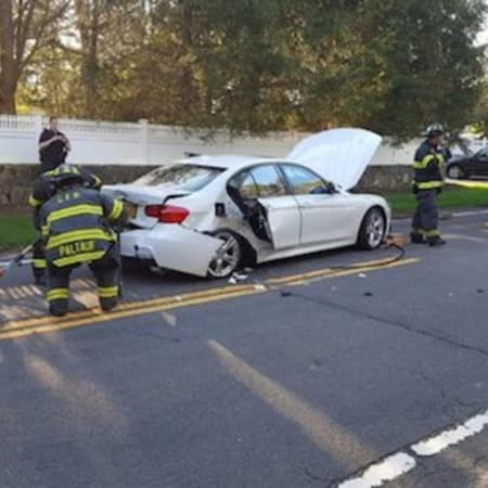 Greenwich firefighters come to the aid of a driver needing extrication after a crash on Riversville Road on Sunday.