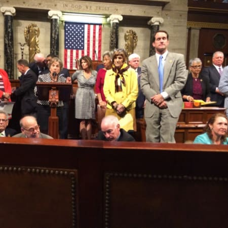 U.S. Rep. Jim Himes, standing right, joins U.S. Rep. Rosa DeLauro, left, and U.S. Rep. Elizabeth Esty, seated, in a sit-in on the floor of the U.S. House on Wednesday.