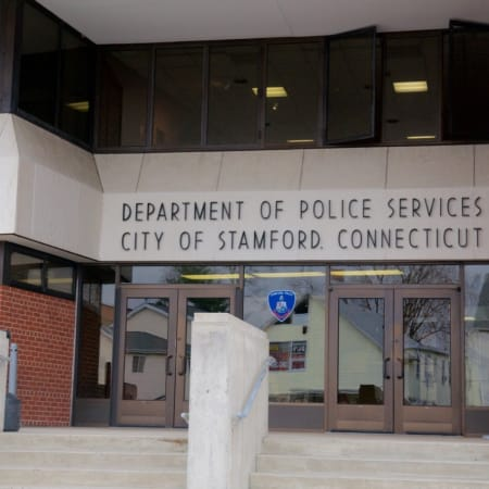 Stamford police arrested a 20-year-old man after finding marijuana and a handgun in his home.