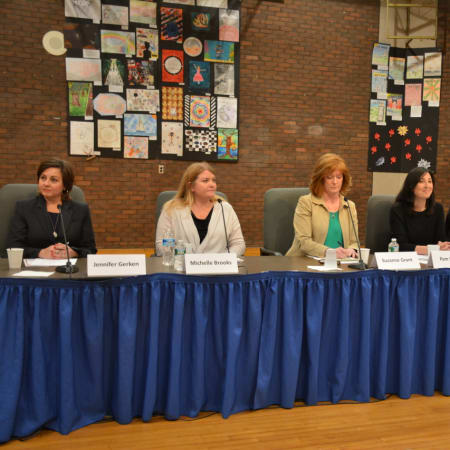 Left to right at a candidates' forum: Jennifer Gerken, Michelle Brooks, Suzanne Grant, Pam Harney, Michael Solomon and Beth Staropoli.
