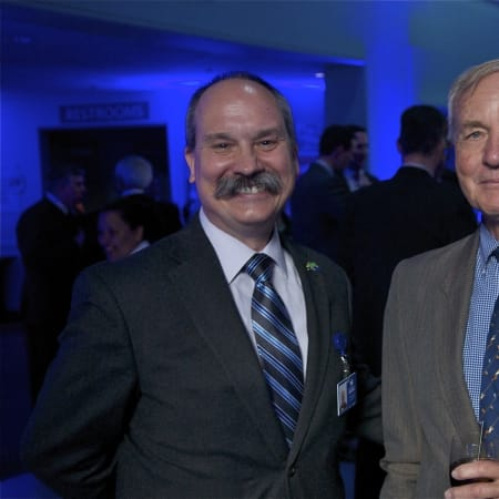 Aquarium marketing director Chris Loynd, left, of Stratford, and Red Apple Award winner Bill Burnham of New Canaan.