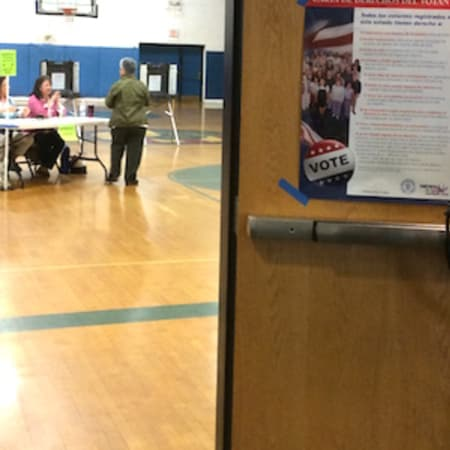 A steady stream of voters head into the War Memorial in Danbury to vote on Tuesday.