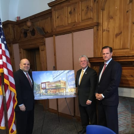 Norwalk Mayor Rilling stands with a representative from the city and General Growth Properties Wednesday at the signing of the land disposition agreement for The SoNo Collection.