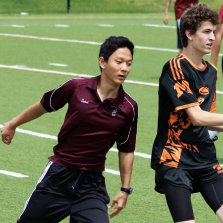 Competition in the New York State Ultimate Frisbee Sectional tournament at Mamaroneck High School on Saturday, May 14.