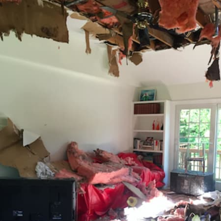 Damage from a fire that started after lightning struck a Thornridge Drive home in Stamford early Tuesday morning. Firefighters had to rip into the room's ceiling in order to put the fire out.