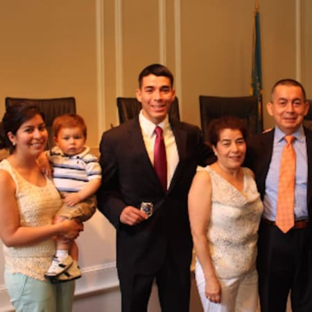 At the City Hall swearing-in ceremony are new Rye Police Officer Christopher Salguero (center), his sister, Stephanie; her son, Dominic; his parents, Nancy and Carlos Salguero; and Rye Police Commissioner Michael C. Corcoran, far right.