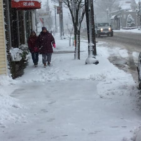 Friday morning's heavy snow isn't stopping these two women from taking a walk all along Greenwood Avenue in downtown Bethel.