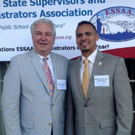 "Mount Vernon principal Ron Gonzalez, right, stands with Region 2-RASA president Michael McDermott in Saratroga Springs after receiving the ""Region 2 Outstanding Administrator of the Year"" award."