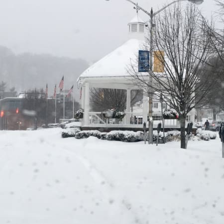 Downtown Pleasantville covered in snow.