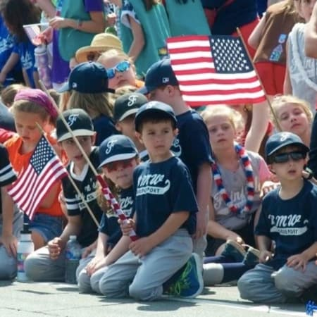 Little Leaguers watch a Memorial Day parade in Fairfield.