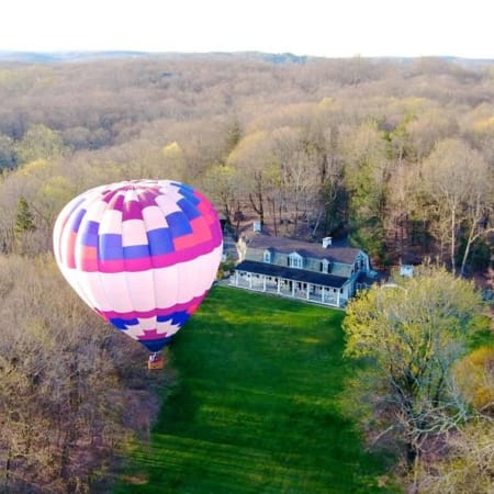 Ginnel Real Estate agent Muffin Dowdle took a hot air balloon trip to help showcase the property at 270-306 Hook Road in Bedford.