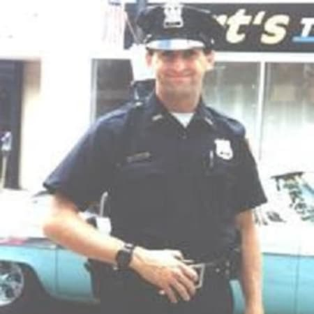Lt. Michael E. Neuner, shown walking the beat as a police officer in Peekskill, was a volunteer firefighter in Brewster. He died in 1997 in the line of duty while battling a house fire in the village.