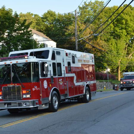 Mount Kisco firefighters responded to a house fire on Kiscona Road that left seven people displaced on Sunday.