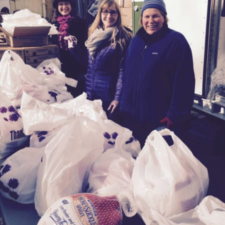 Volunteers with the Junior League of Bronxville delivering food to families in need last year. They will bring a Kraft Mobile Food Pantry to Mount Vernon on Saturday at the Parker Elementary School.