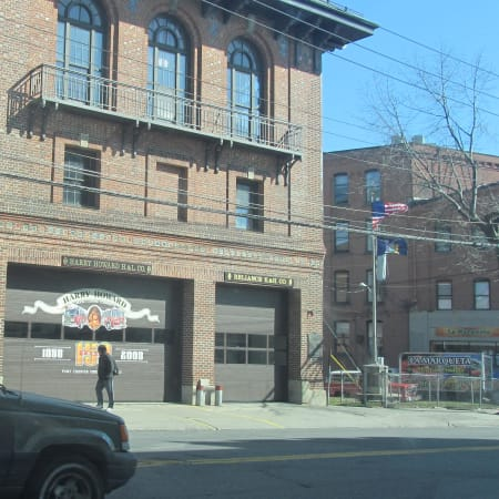 The attorney for the paid firefighters laid off in Port Chester is accusing the volunteer fire chief of encouraging other volunteer firefighters to damage the Port Chester home of a professional firefighter.