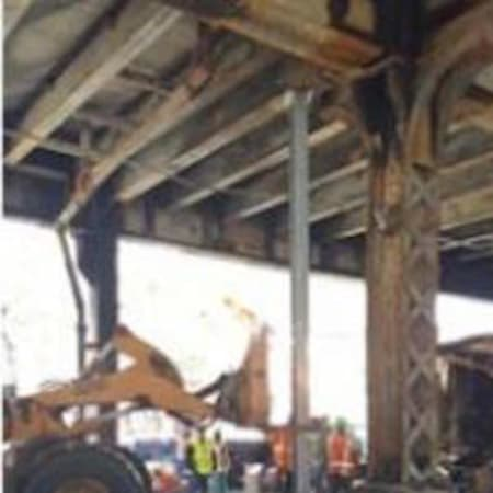 Metro-North crews work Wednesday to repair damage to the Viaduct after a fire Tuesday.
