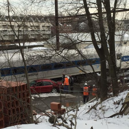 A Danbury-bound train slammed into a car on the tracks at a private grade crossing in Central Norwalk on Tuesday afternoon.