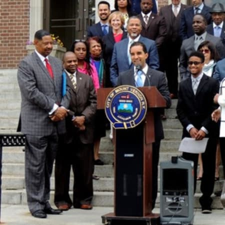 """Flanked by Schools Superintendent Kenneth Hamilton and other city stakeholders, Mount Vernon Mayor Richard Thomas accepted President Barack Obama's """"My Brother's Keeper"""" challenge."""